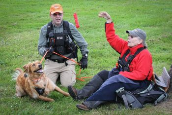 Ruger about to receive his reward toy from Dana Lerma, whom he'd tracked for about a mile through Port Gamble, WA. (Photo by JB Goessman)